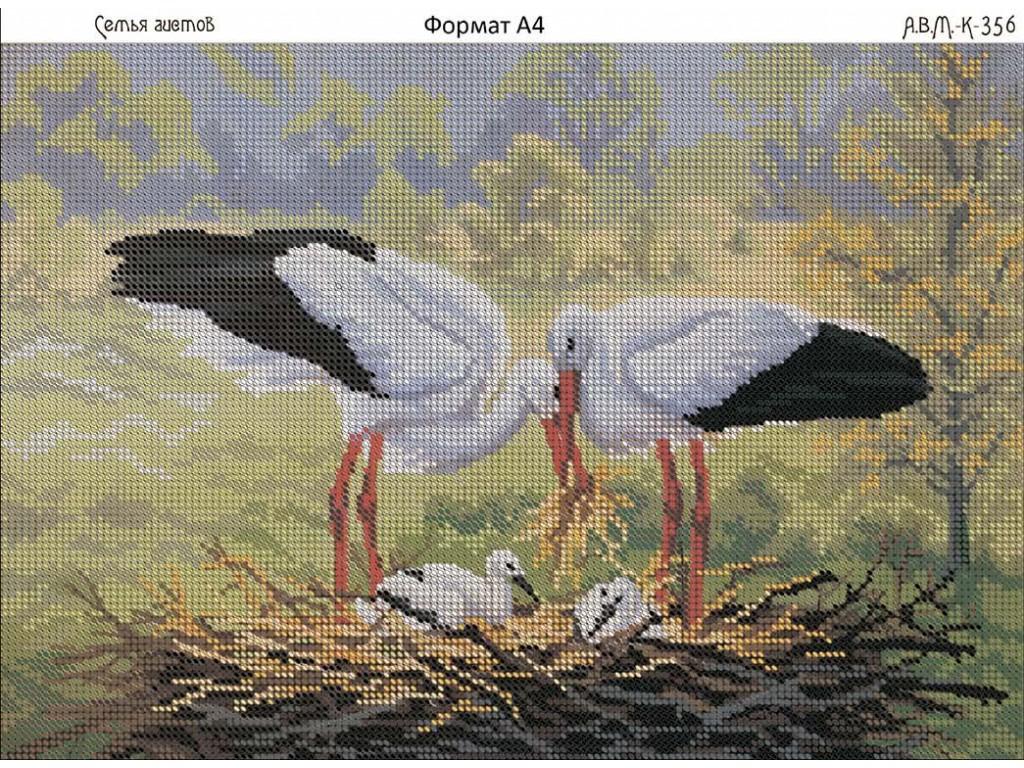 Вышивка гнездо с аистами